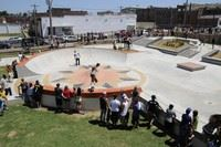 People skating in a city skate park